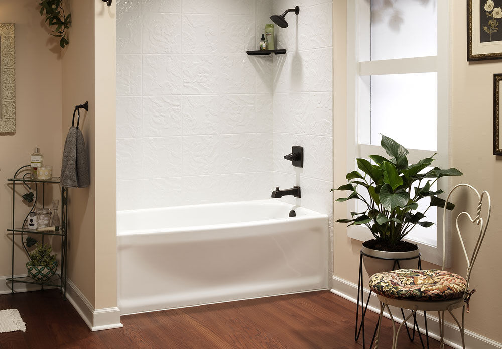 new modern tub with beautiful wall surround in remodeled bathroom